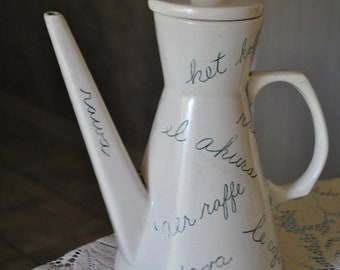 Modernist vintage 60s handcrafted  ironstone coffee pot with etched  international words of  the coffee.