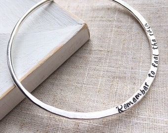 Personalised hammered sterling silver message bangle bracelet. Metal stamped quote bangle. Engraved silver bangle.