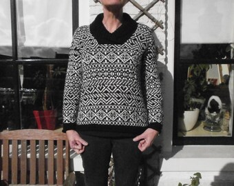 Black White Scandinavian-inspired sweater with scarf collar.