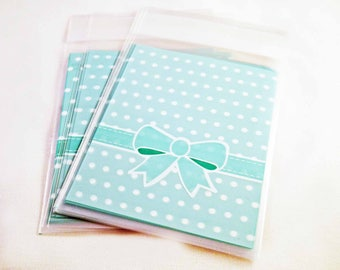 AD08 - Set of 5 bags pouches plastic self-adhesive blue polka dots with bow