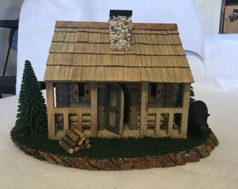 Diorama of cabin with bear