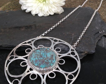 British handmade large silver circles pendant with a Shattukite Turquoise stone hanging from a chunky chain