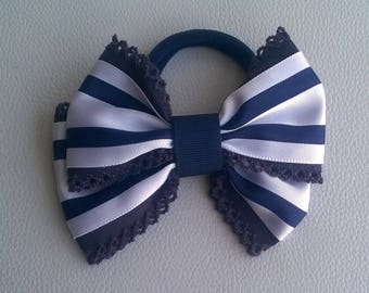 Blue and white striped rubber loop