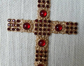 Large Hobe cross dressed with garnet color rhinestones and ruby red glass cachabons