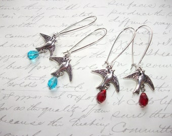 Silver bird earrings with red or blue crystal drops