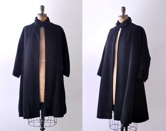 50's black swing coat. large. 1950's sheered wool coat. cropped sleeves. collar.