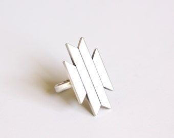 "Unique modern silver ring design inspired by travels to Morocco constructed of four rectangular angled silver shapes - ""Linterna Ring"""