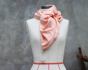 Pastel peach weighted scarf with large white howlite skull charm