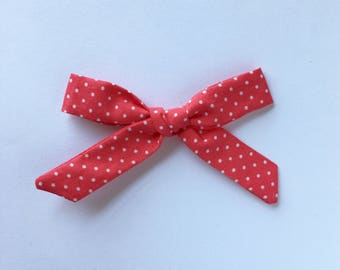 Skinny knotted bows in Watermelon. Headband or hair clip.