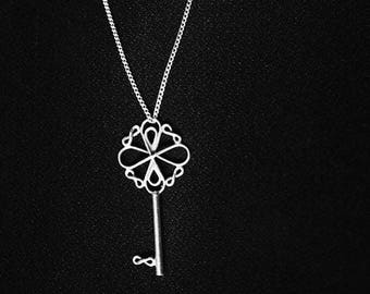 Handmade silver Infinite key necklace holds a message of infinite love and hope straight from the heart of the Father