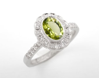 Oval peridot halo engagement ring. Grace Classy. Diamond ring, vintage halo ring, vintage style, millegrain, scalloped, white gold.