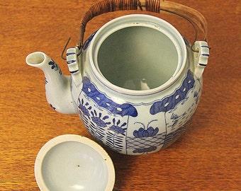 Chinese celadon porcelain tea pot with blue decor