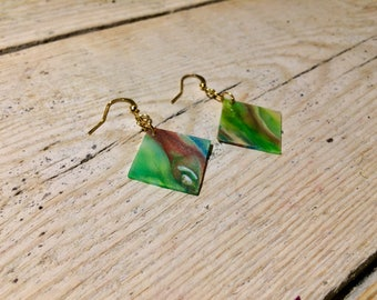 Earrings made of recycled bottle caps