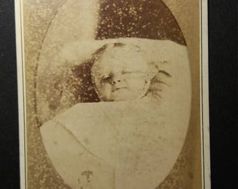 Post mortem CDV card of a baby on bed by J. Bottomley photo