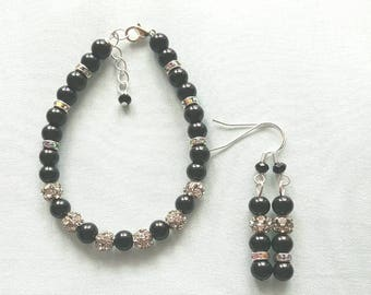 Black and rhinestone bracelet and earring set