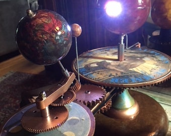 Artist enhanced tellurion planetarium orrery earth moon sun solar system model