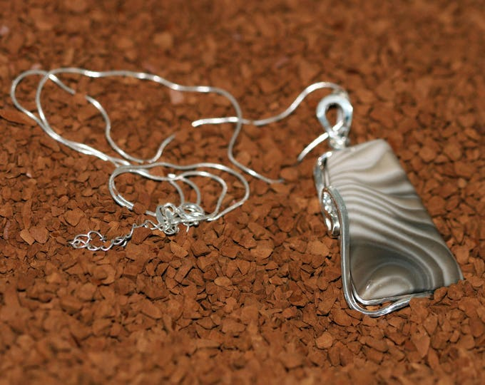 Gorgeous Striped Flint Pendant fitted in the sterling silver setting. Handmade & unique.