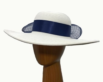 Large white hat, dress casual.  Adorned with Navy blue bow and crinoline.  For Summer, Casual, Dress casual, church, derby.