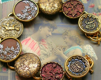 """RESERVED Cupid Antique BUTTON bracelet, Victorian Eros & Flowers on gold, 7.5"""" jewellery."""