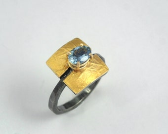 A unique hammered engagement ring made of gold and silver and a quality genuine aquamarine gemstone, Geometric ring, Textured ring.