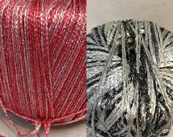 Red And Black Metallic Skeins Of Yarn