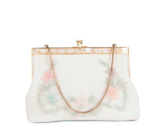 Mother of pearl and embroidered minaudiere