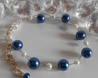Wedding bracelet twist of dark blue and white beads