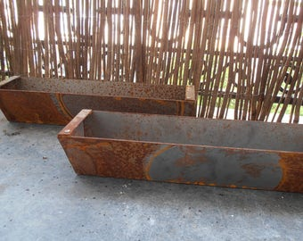 Two rusted French vintage metal troughs