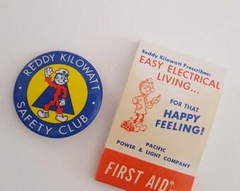 Vintage lot of Reddy Kilowatt button and pocket first aid kit, Pacific Power & Light, Nuke Power, Walter Lantz