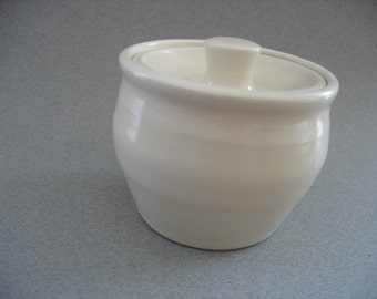 Small covered jar.