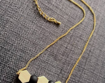 Gold chain necklace and wooden beads