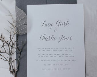 Printed, Classic Wedding Invitations paired with Beautiful Script and Fonts includes Envelopes.