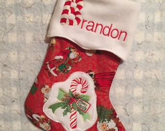 Handsewn Christmas Stockings with embroidered designs, personalized with name