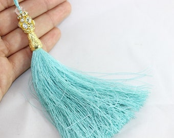 1 Pc Turquoise Silky Thread Tassel 130 mm with Rhinestones and Gold Tone Caps for your lovely designs