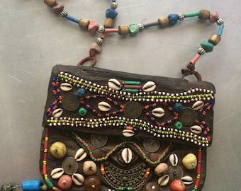 Lovely antique Moroccan leather handbag with stones, coins, shells and beads.