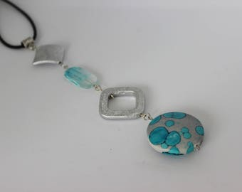 Original vertical necklace in turquoise and gray acrylic.