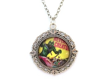 Creature from the Black Lagoon Necklace: vintage-inspired glass cabochon pendant.