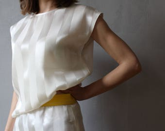 Sleeveless top with bow detail