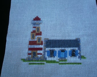 BRETON House with its cross point lighthouse