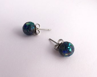Faux-opal eco-resin studs with embedded on allergy-friendly backs.