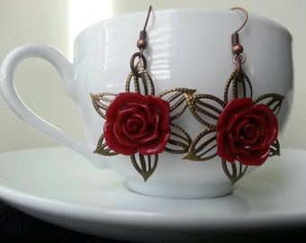 Deep red rose earrings with Bronze poinsettia filigree
