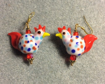 White and red polka dotted lampwork chicken bead earrings adorned with red Czech glass beads.
