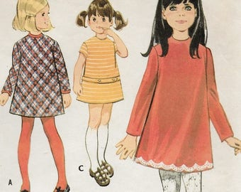 "An A-Line, Collarless, Long or Short Sleeve Dress with Trim Variations Sewing Pattern for Children: Size 3, Breast 22"" • McCall's 2212"