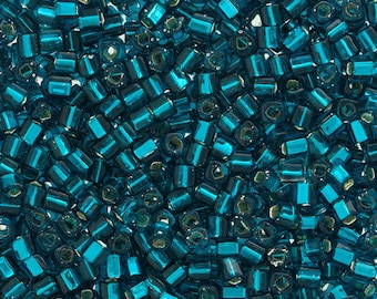 Toho 1.5mm Cube Silver lined Teal 13g.