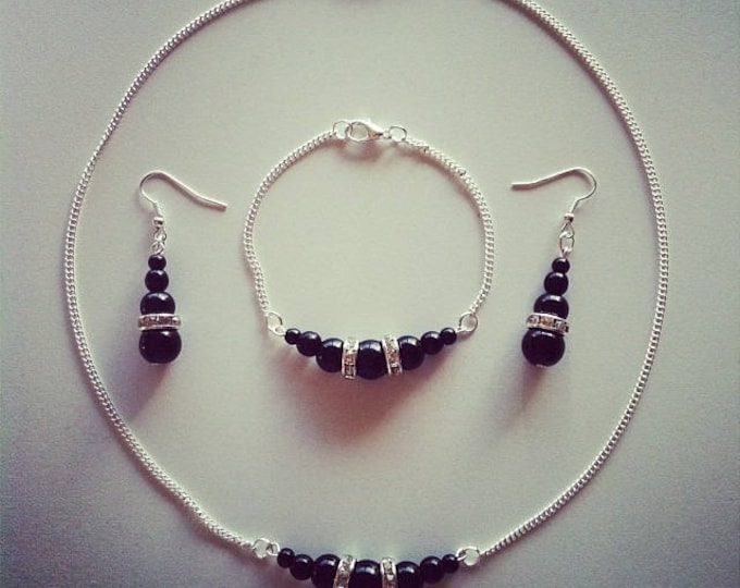 Silver set black beads and rhinestones