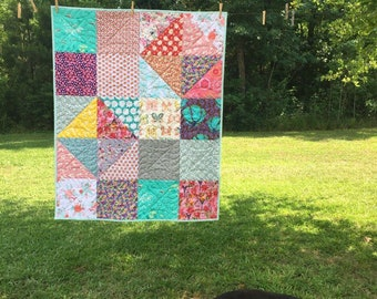 Floral quilt made in bohemian scrap style