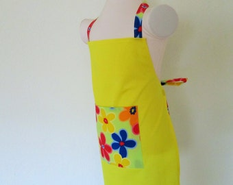Childrens Apron-Sunshine Solid Yellow with a Hip Bright Flower Power print on the Pocket and Straps, A fun kids apron to cook and create in