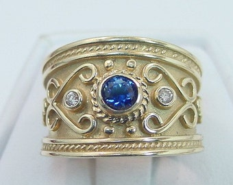 AAAA Blue Sapphire   4.00mm  .36 Carats   in 14K Yellow gold diamond ring (.06 carats) 0404