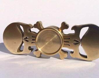 Skull spinner fidget for EDC. Brass, ceramic bearing