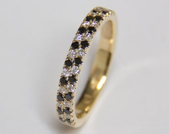 Ring of gold with black and white diamonds